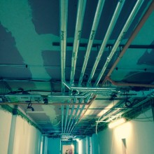 Insulation over 4 floors' pipework in care home in U-shaped corridors. Heating and cold water pipes.